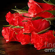Red Roses On Wood Floor Poster