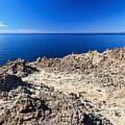 rocky coast in San Pietro island Poster