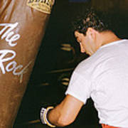 Rocky Marciano Vs. Heavy Bag Poster by Retro Images Archive