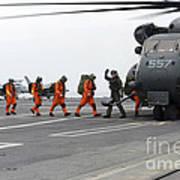 Sailors Board An Mh-53e Sea Dragon Poster