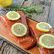 Salmon On A Cutting Board With Lemon Poster