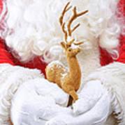 Santa Holding Reindeer Figure Poster