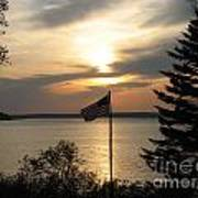 Silhouetted Flag At Sunset Poster
