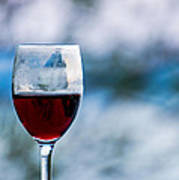Single Glass Of Red Wine On Blue And White Background Poster