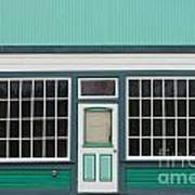 Small Store Front Entrance To Green Wooden House Poster