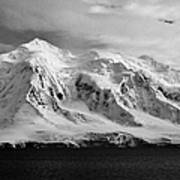snow covered landscape of anvers island mountain range and neumayer channel Antarctica Poster