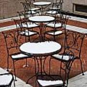 Snow Covered Patio Chairs And Tables Poster