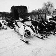 snowmobiles parked in Kamsack Saskatchewan Canada Poster