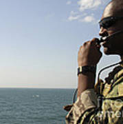 Soldier Instructs Small Boat Maneuvers Poster
