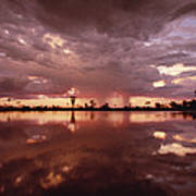 Sunset And Clouds Over Waterhole Poster