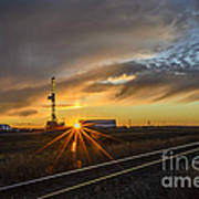 Sunset At The Edge Of Oil Rigs Poster