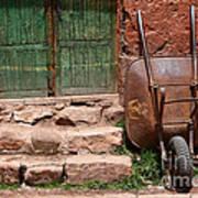 Rusty Wheelbarrow And Green Door Poster