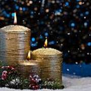 Three Gold Candles In Snow  Poster