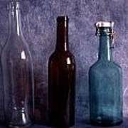 Three Old Empty Bottles On Painted Background Poster by IB Photo
