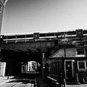 train going over railway bridge elevated section of track southwark London England UK Poster