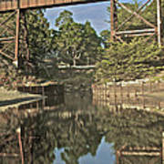 Trestle Over Reflecting Water Poster