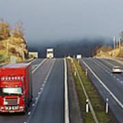 Trucks Driving Through A Misty Mountain Pass Poster