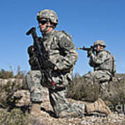U.s. Army Soldiers Scan The Terrain Poster