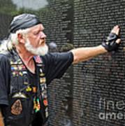 Vietnam Veteran Pays Respect To Fallen Soldiers At The Vietnam War Memorial  Poster