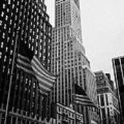 view of pennsylvania bldg nelson tower and US flags flying on 34th street from 1 penn plaza new york Poster