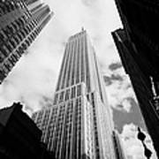 View Of The Empire State Building And Surrounding Buildings And Cloudy Sky West 33rd Street New York Poster