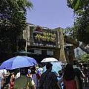 Visitors Thronging The Jurassic Park Rapids Adventure Ride Poster