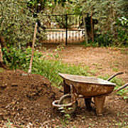 Wheel Barrow Next To Soil Heap Poster