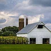 White Barn And Silo With Storm Clouds Poster