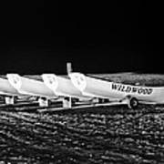Wildwood Lifeboats At Night In Black And White Poster