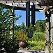 Wind Chime In A Garden Poster