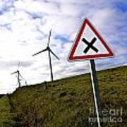 Wind Turbines On The Edge Of A Field With A Road Sign In Foreground. Poster