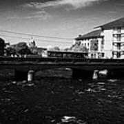 wolfe tone bridge and jurys hotel next to the quays on the corrib river Galway city county Galway Republic of Ireland Poster
