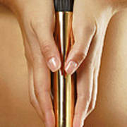 Woman Holding A Gold Vibrator Poster