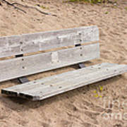 Wooden Bench Burried In The Sand Poster