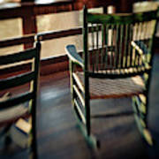 Wooden Rocking Chairs On A Deck Poster