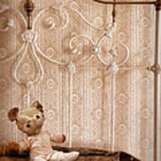 Worn Teddy Bear On Brass Bed Poster