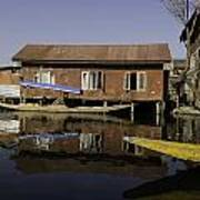 Yellow Shikara In Front Of A Run Down Area Of Houses In The Dal Lake Poster