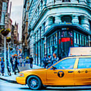 Yellow Taxi In Front Of New York City's Flatiron Building Poster