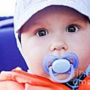Young Baby Boy With A Dummy In His Mouth Outdoors Poster