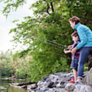 Young Mother Helping Son Fish At Kezar Poster