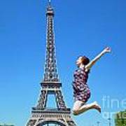 Young Woman Jumping Against Eiffel Tower Poster