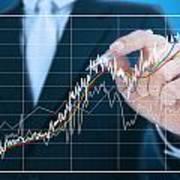 Businessman Writing Graph Of Stock Market  Poster by Setsiri Silapasuwanchai