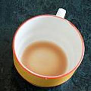 A Cup With The Remains Of Tea On A Green Table Poster