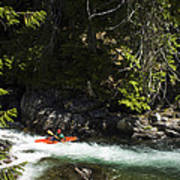 A Kayaker Paddles In A Rapid As Seen Poster