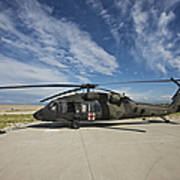 A Uh-60l Blackhawk Parked On Its Pad Poster