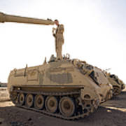 A Us Army Mechanic Uses A M113 Poster