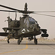 An Ah-64 Apache Helicopter Taxiing Poster
