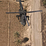 An Ah-64d Apache Helicopter In Flight Poster