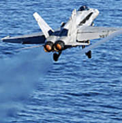 An Fa-18c Hornet Taking Off Poster