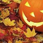 Carved Pumpkin On Fallen Leaves Poster